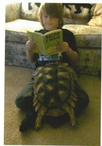 Donovan Neuhaser with Sushi the sulcata
